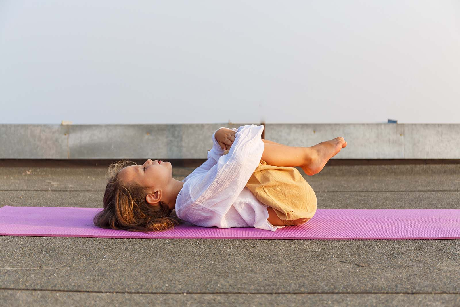 Baby doing yoga on the roof